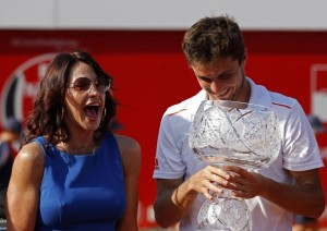 Romanian former gymnast star Comaneci laughs next to Simon during the awards ceremony of the BRD Nastase Tiriac Trophy tennis tournament in Bucharest